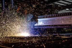 Steel 21 has been revolutionizing the Steel Industry for years. A look at the interior of the Steel 21 facility while a piece of steel is being cut.